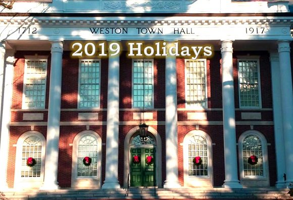 town hall with holiday wreaths