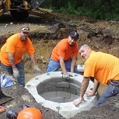 DPW employees installing a drainage pipe