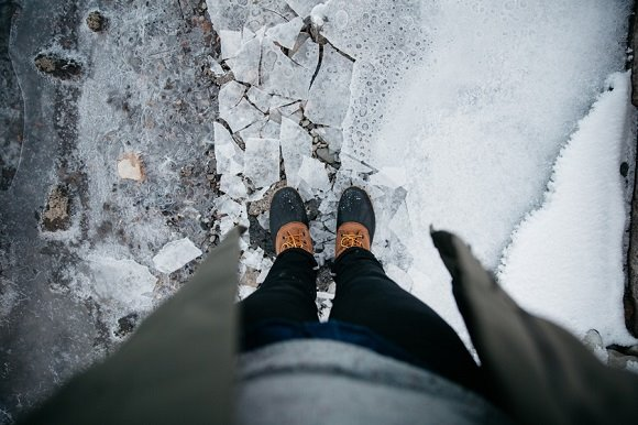 person standing on thin and cracking ice