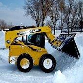 bobcat pushing snow
