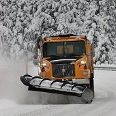 large snow plow on road
