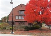 Picture of fall tree and the community center
