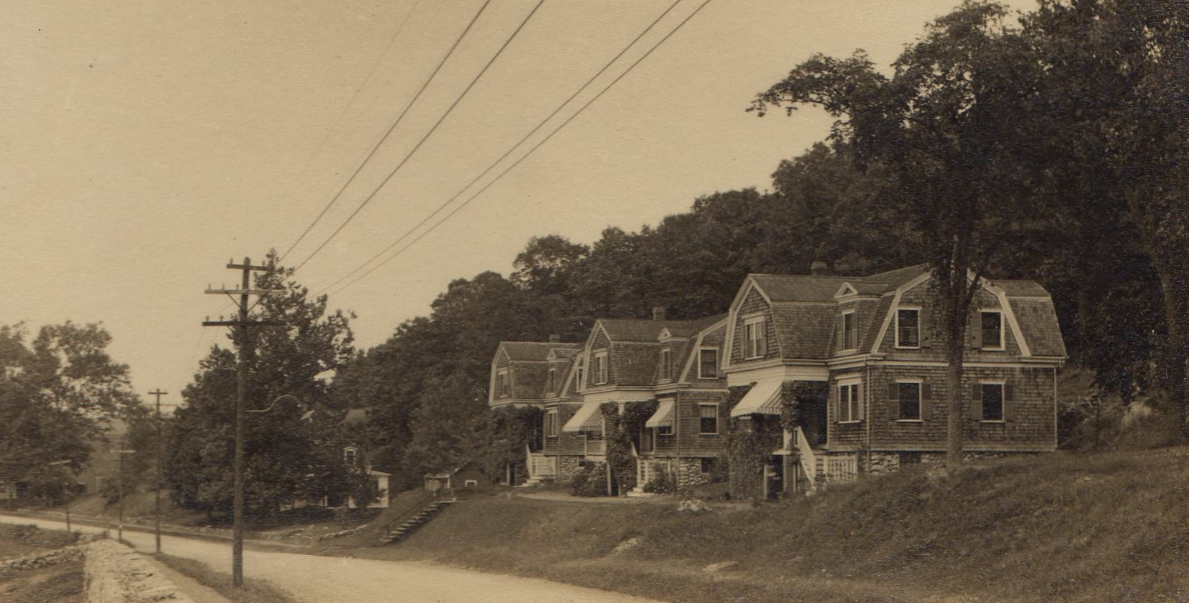 Row of 3 houses built for organ factory workers at 225- 231 North Avenue, mid-1890s