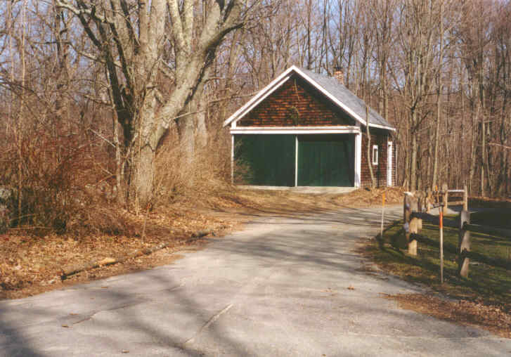 An outbuilding with green siding
