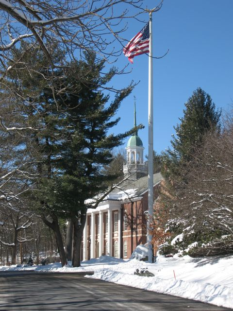 Town Hall in Snow with American Flag