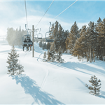 ski lift, snow and evergreen treees