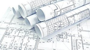 Papers with engineering drawings.