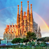 Sagrada Familia cathedral with rainbow in background